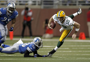 DETROIT, MI - DECEMBER 12:  Aaron Rodgers #12 of the Green Bay Packers is tackled during a second half run by Brandon McDonald #33 of the Detroit Lions on December 12, 2010 at Ford Field in Detroit, Michigan.  (Photo by Gregory Shamus/Getty Images)