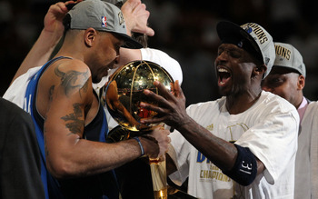 MIAMI, FL - JUNE 12:  (L-R) Shawn Marion #0 and Jason Terry #31 of the Dallas Mavericks celebrate with the Larry O'Brien trophy after the Mavericks won 105-95 against the Miami Heat in Game Six of the 2011 NBA Finals at American Airlines Arena on June 12,