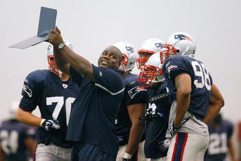 FOXBORO, MA - JULY 24:  Defensive Line Coach Pepper Johnson of the New England Patriots provides instruction in a drill during the first day of training camp at Gillette Stadium on July 24, 2008 in Foxboro, Massachusetts.  (Photo by Jim Rogash/Getty Image