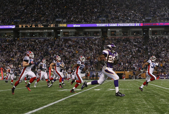 MINNEAPOLIS, MN - DECEMBER 05:  Adrian Peterson #28 of the Minnesota Vikings rushes for a touchdown against the Buffalo Bills at the Mall of America Field at the Hubert H. Humphrey Metrodome on December 5, 2010 in Minneapolis, Minnesota.  (Photo by Nick L