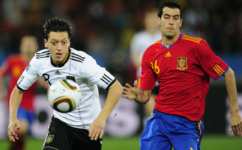 Mesut Ozil and Sergio Busquets