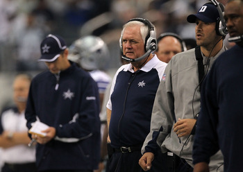 ARLINGTON, TX - OCTOBER 31:  Head coach Wade Phillips (C) and injured quarterback Tony Romo (R) of the Dallas Cowboys look on against the Jacksonville Jaguars at Cowboys Stadium on October 31, 2010 in Arlington, Texas.  (Photo by Ronald Martinez/Getty Ima