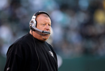 OAKLAND, CA - NOVEMBER 28:  Head coach Tom Cable of the Oakland Raiders walks the sidelines during the closing minutes of their loss to the Miami Dolphins at Oakland-Alameda County Coliseum on November 28, 2010 in Oakland, California.  (Photo by Ezra Shaw