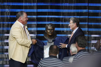 CANTON, OH - AUGUST 7: Russ Grimm and presenter Joe Bugel unveil Grimm's bust during the 2010 Pro Football Hall of Fame Enshrinement Ceremony at the Pro Football Hall of Fame Field at Fawcett Stadium on August 7, 2010 in Canton, Ohio. (Photo by Joe Robbin
