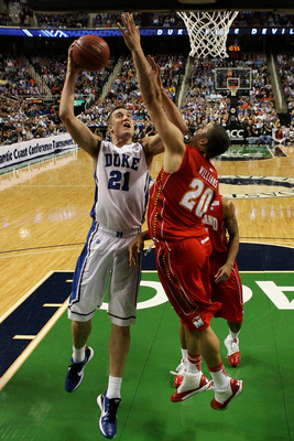 GREENSBORO, NC - MARCH 11:  Miles Plumlee #21 of the Duke Blue Devils shoots against Jordan Williams #20 of the Maryland Terrapins during the second half in the quarterfinals of the 2011 ACC men's basketball tournament at the Greensboro Coliseum on March