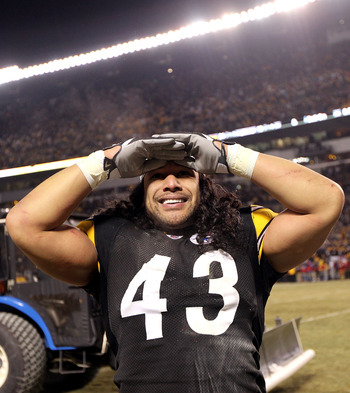 PITTSBURGH, PA - JANUARY 23:  Troy Polamalu #43 of the Pittsburgh Steelers celebrates their 24 to 19 win over the New York Jets in the 2011 AFC Championship game at Heinz Field on January 23, 2011 in Pittsburgh, Pennsylvania.  (Photo by Nick Laham/Getty I