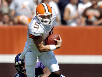 CLEVELAND, OH - SEPTEMBER 12:  Cleveland Browns quarterback Jeff Garcia #5 is sacked by cornerback Gary Baxter #28 of the Baltimore Ravens during the first quarter on September 12, 2004 at Cleveland Browns Stadium in Cleveland, Ohio.  (Photo by David Maxw