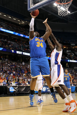TAMPA, FL - MARCH 19:  Joshua Smith #34 of the UCLA Bruins attempts a shot against the Florida Gators during the third round of the 2011 NCAA men's basketball tournament at St. Pete Times Forum on March 19, 2011 in Tampa, Florida. Florida won 73-65.  (Pho