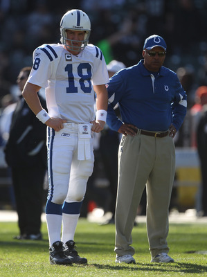 OAKLAND, CA - DECEMBER 26:  Peyton Manning #18 of the Indianapolis Colts looks on with head coach Jim Caldwell against the Oakland Raiders during an NFL game at Oakland-Alameda County Coliseum on December  26, 2010 in Oakland, California.  (Photo by Jed J