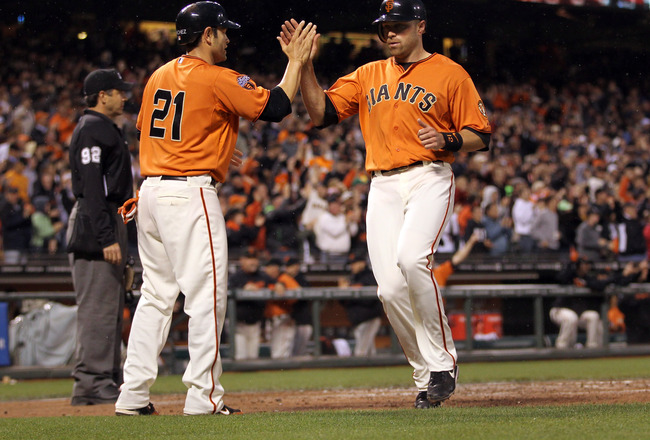 SAN FRANCISCO, CA - JUNE 03:  Freddy Sanchez #21 and Nate Schierholtz #12 of the San Francisco Giants congratulate one another after they both scored on a double by Cody Ross #13 of the San Francisco Giants in the fourth inning against the Colorado Rockie