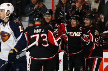 OTTAWA, ON - DECEMBER 13:  Daniel Alfredsson #11 of the Ottawa Senators celebrates his goal with teammates Jarkko Ruutu #73;Chris Phillips #4 and Mike Fisher #12 while Chris Thornburn #27 of the Atlanta Thrashers skates away dejectedly in a game at Scotia