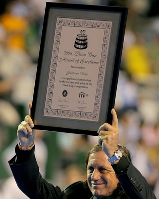 MAR DEL PLATA, ARGENTINA - NOVEMBER 22: Guilermo Vilas displays an Award of Excellence presented to him before the third rubber of the Davis Cup final at Estadia Islas Malinas November 22, 2008 in Mar del Plata, Argentina.  (Photo by Matthew Stockman/Gett