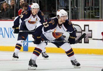 NEWARK, NJ - DECEMBER 31:  Jim Slater #23 and Tobias Enstrom #39 of the Atlanta Thrashers skate against the New Jersey Devils at the Prudential Center on December 31, 2010 in Newark, New Jersey. The Devils defeated the Thrashers 3-1.  (Photo by Jim McIsaa