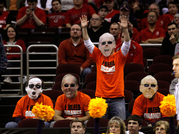 CLEVELAND, OH - MARCH 20:  Fans wear head coach Jim Boeheim of the Syracuse Orange masks during the game between the Syracuse Orange and the Marquette Golden Eagles during the third of the 2011 NCAA men's basketball tournament at Quicken Loans Arena on Ma