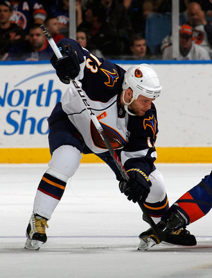 UNIONDALE, NY - MARCH 24:  Rob Schremp #13 of the Atlanta Thrashers takes a faceoff during an NHL hockey game against the New York Islanders at the Nassau Coliseum on March 24, 2011 in Uniondale, New York.  (Photo by Paul Bereswill/Getty Images)
