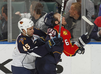 SUNRISE, FL - JANUARY 17: Patrice Cormier #45 of the Atlanta Thrashers checks Dennis Wideman #6 of the Florida Panthers on January 17, 2011 at the BankAtlantic Center in Sunrise, Florida. The Thrashers defeated the Panthers 3-2 in a shoot out. (Photo by J