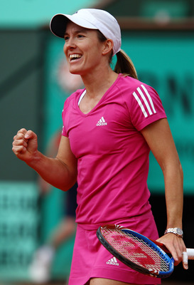 PARIS - MAY 30:  Justine Henin of Belgium celebrates winning match point during the women's singles third round match between Justine Henin of Belgium and Maria Sharapova of Russia on day eight of the French Open at Roland Garros on May 30, 2010 in Paris,