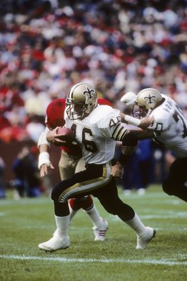 SAN FRANCISCO - SEPTEMBER 29:  Running back Hokie Gajan #46 of the New Orleans Saints finds room to run against the San Francisco 49ers defense during a game at Candlestick Park on September 29, 1985 in San Francisco, California.  The Saints won 20-17.  (