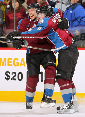 DENVER, CO - JANUARY 10:  Matt Duchene #9 of the Colorado Avalanche celebrates his second goal in the first period with teammate Tomas Fleischmann #14 against  the Detroit Red Wings at the Pepsi Center on January 10, 2011 in Denver, Colorado.  (Photo by D