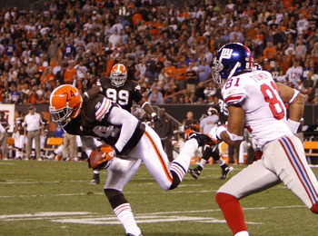 CLEVELAND - OCTOBER 13:  Eric Wright #24 of the Cleveland Browns makes a fourth quarter interception that he returned 93 yards for a touchdown against Amani Toomer #81 of the New York Giants on October 13, 2008 at Cleveland Browns Stadium in Cleveland, Oh