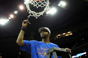 KANSAS CITY, MO - MARCH 12:  Markieff Morris #21 of the Kansas Jayhawks celebrates by cutting down the net after defeating the Texas Longhorns 85-73 to win the 2011 Phillips 66 Big 12 Men's Basketball Tournament championship game at Sprint Center on March