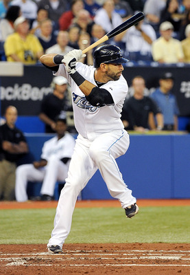 TORONTO, ON - SEPTEMBER 22: Jose Bautista #19 of the Toronto Blue Jays prepares to swing at the ball during a game against the Seattle Mariners on September 22, 2010 in Toronto, Canada. (Photo by Matthew Manor/Getty Images)