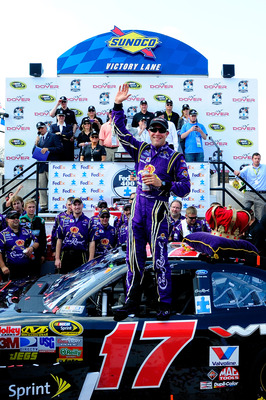 DOVER, DE - MAY 15:  Matt Kenseth, driver of the #17 Wiley X Sunglasses Ford, celebrates in Victory Lane after winning the NASCAR Sprint Cup Series FedEx 400 Benefiting Autism Speaks at Dover International Speedway on May 15, 2011 in Dover, Delaware.  (Ph