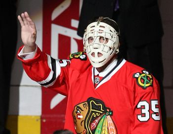 CHICAGO - MARCH 19: Former goaltender Tony Esposito of the Chicago Blackhawks dones his old face mask and waves to the crowd during a ceremony before a game between the Blackhawks and the Washington Capitals on March 19, 2008 at the United Center in Chica