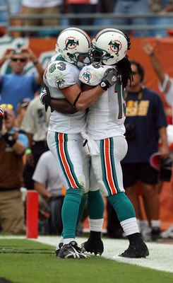 MIAMI - DECEMBER 06:  Wide receiver Davone Bess #15 and offensive lineman Andrew Gardner #63 of the Miami Dolphins celebrate after Bess' touchdown catch against the New England Patriots at Land Shark Stadium on December 6, 2009 in Miami, Florida. The Dolp