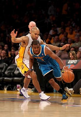 LOS ANGELES, CA - APRIL 17:  Chris Paul #3 of  the New Orleans Hornets gets past Derek Fisher #2 of the Los Angeles Lakers in Game One of the Western Conference Quarterfinals in the 2011 NBA Playoffs on April 17, 2011 at Staples Center in Los Angeles, Cal
