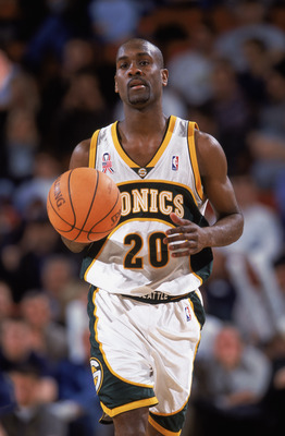 12 Feb 2002:  Point guard Gary Payton #20 of the Seattle SuperSonics dribbles the ball during the NBA game against the Dallas Mavericks at the Key Arena in Seattle, Washington. The Mavericks defeated the Sonics 112-106.  NOTE TO USER:  User expressly ackn