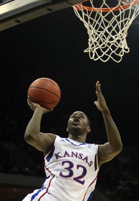 TULSA, OK - MARCH 18:  Josh Selby #32 of the Kansas Jayhawks goes up for a shot against the Boston University Terriers during the second round of the 2011 NCAA men's basketball tournament at BOK Center on March 18, 2011 in Tulsa, Oklahoma.  (Photo by Rona