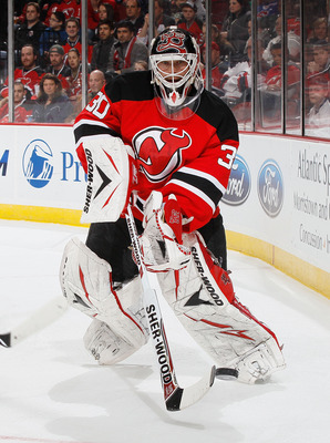 NEWARK, NJ - MARCH 12:  Goaltender Martin Brodeur #30 of the New Jersey Devils clears the puck behind the net against the New York Islanders on March 12, 2011 at the Prudential Center in Newark, New Jersey. Devisl defeated the Islanders 3-2 in OT. (Photo