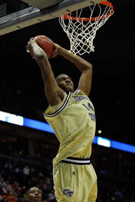 MILWAUKEE - MARCH 19:  Iman Shumpert #1 of the Georgia Tech Yellow Jackets dunks the ball in the second half against the Oklahoma State Cowboys during the first round of the 2010 NCAA men's basketball tournament at the Bradley Center on March 19, 2010 in