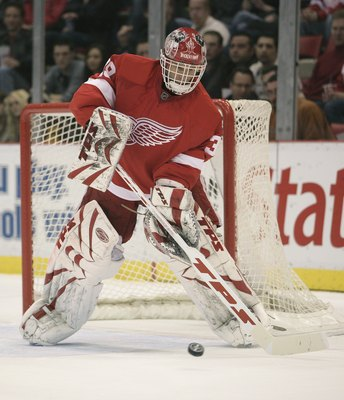 DETROIT - JANUARY 17:  Dominic Hasek #39 of the Detroit Red Wings comes out to corral a shot cleared in a game against the Vancouver Canucks on January 17, 2008 at the Joe Louis Arena in Detroit, Michigan. The Wings defeated the Canucks 3-2 in a shootout.