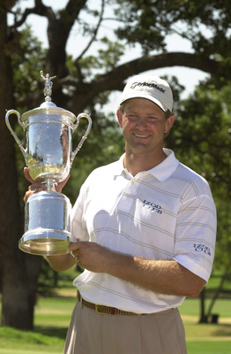 18 Jun 2001:  Retief Goosen of South Africa poses with the trophy after winning the 101st US Open at Southern Hills Country Club in Tulsa, Oklahoma. DIGITAL IMAGE Mandatory Credit: Matthew Stockman/ALLSPORT