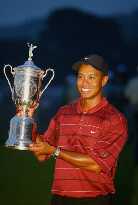 FARMINGDALE, NY - JUNE 16:  Tiger Woods poses with the trophy after winning the102nd US Open on the Black Course at Bethpage State Park in Farmingdale, New York on June 16, 2002.  (Photo By Jamie Squire/Getty Images)