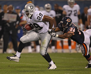 CHICAGO - AUGUST 21: Michael Bush #29 of the Oakland Raiders breaks away from Danieal Manning #38 of the Chicago Bears during a preseason game at Soldier Field on August 21, 2010 in Chicago, Illinois.  (Photo by Jonathan Daniel/Getty Images)