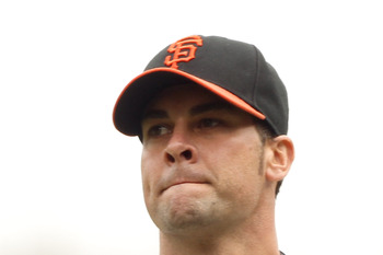 SAN FRANCISCO, CA - JUNE 05:  Ryan Vogelsong #32 of the San Francisco Giants reacts after giving up a home run to Chris Iannetta #20 of the Colorado Rockies at AT&T Park on June 5, 2011 in San Francisco, California.  (Photo by Ezra Shaw/Getty Images)