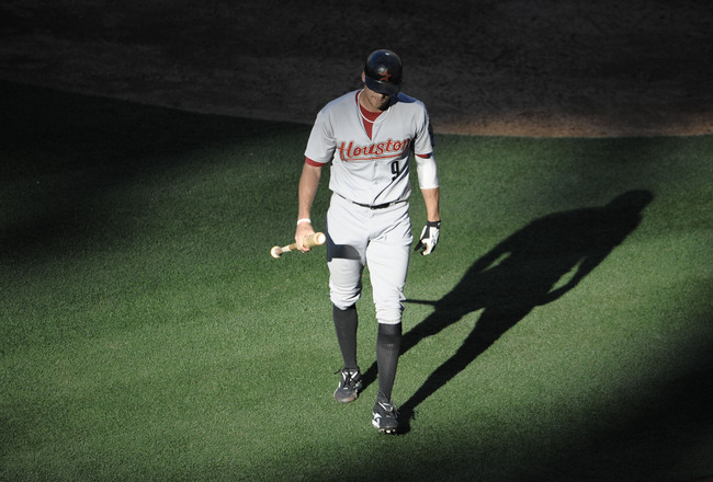 SAN DIEGO, CA - JUNE 5: Hunter Pence #9 of the Houston Astros walks off the field after striking out during the seventh inning of a baseball game against the San Diego Padres at Petco Park on June 5, 2011 in San Diego, California.  (Photo by Denis Poroy/G
