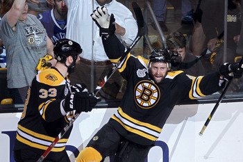 Boston's Zdeno Chara (33) and Rich Peverley celebrate Peverley's goal against Vancouver in Game 4 of the 2011 Stanley Cup Finals