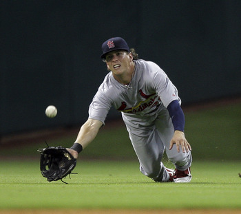 HOUSTON - JUNE 08:  Center fielder Colby Rasmus  #28 of the St. Louis Cardinals dives but comes up short on a sinking line drive hit by J.R. Towles #46 of the Houston Astros at Minute Maid Park on June 8, 2011 in Houston, Texas.  (Photo by Bob Levey/Getty