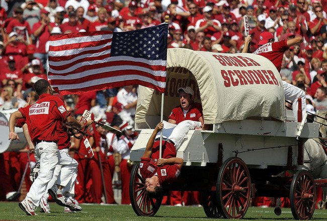 NORMAN, OK - SEPTEMBER 11:  The Oklahoma Sooner Schooner carries the American flag on the anniversary of September 11  at Gaylord Family Oklahoma Memorial Stadium on September 11, 2010 in Norman, Oklahoma.  (Photo by Ronald Martinez/Getty Images)