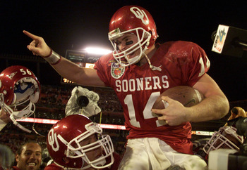 3 Jan 2001:  Quarterback Josh Heupel #14 of the Oklahoma Sooners is hoisted by his teammates after defeating the Florida State Seminoles during the Orange Bowl at Pro Player Stadium in Miami, Florida. <DIGITAL IMAGE> Mandatory Credit: Andy Lyons/ALLSPORT