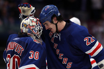 NEW YORK, NY - APRIL 17:  (L-R) Goalie Henrik Lundqvist #30 and Brian Boyle #22 of the New York Rangers celebrate after the Rangers won 3-2 against the Washington Capitals in Game Three of the Eastern Conference Quarterfinals during the 2011 NHL Stanley C