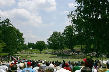 BETHESDA, MD - JULY 07:  Golf fans watch as Tiger Woods putts on the sixth green during the third round of the AT&T National at Congressional Country Club on July 7, 2007 in Bethesda, Maryland.  (Photo by Scott Halleran/Getty Images)