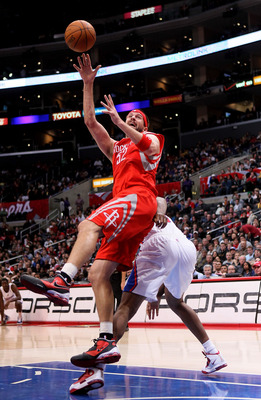 LOS ANGELES, CA - DECEMBER 22:  Brad Miller #52 of the Houston Rockets makes an off balance but scores a basket against the Los Angeles Clippers at Staples Center on December 22, 2010 in Los Angeles, California.  The Rockets won 97-92. NOTE TO USER: User