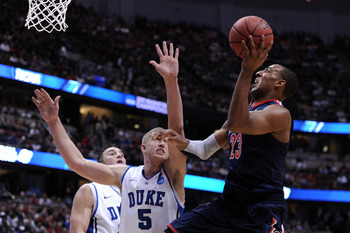 ANAHEIM, CA - MARCH 24:  Derrick Williams #23 of the Arizona Wildcats goes to the basket against Mason Plumlee #5 of the Duke Blue Devils during the west regional semifinal of the 2011 NCAA men's basketball tournament at the Honda Center on March 24, 2011