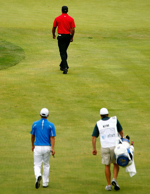 BETHESDA, MD - JULY 05:  Tiger Woods walks to the 17th green ahead of Anthony Kim and his caddie  during the final round of the AT&T National at the Congressional Country Club on July 5, 2009 in Bethesda, Maryland.  (Photo by Scott Halleran/Getty Images)