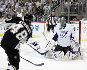 PITTSBURGH, PA - APRIL 23:  Dwayne Roloson #35 of the Tampa Bay Lightning makes a save on Tyler Kennedy #48 of the Pittsburgh Penguins in Game Five of the Eastern Conference Quarterfinals during the 2011 NHL Stanley Cup Playoffs at Consol Energy Center on
